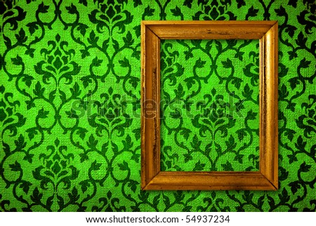 Gold frame on a vintage green wall background