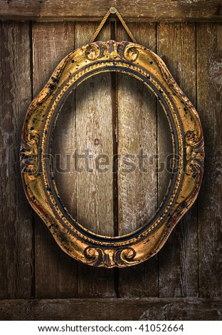 Gold frame on a wooden background - stock photo
