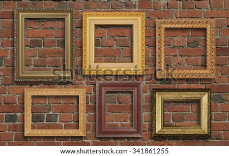 gold frame on brick wall - stock photo