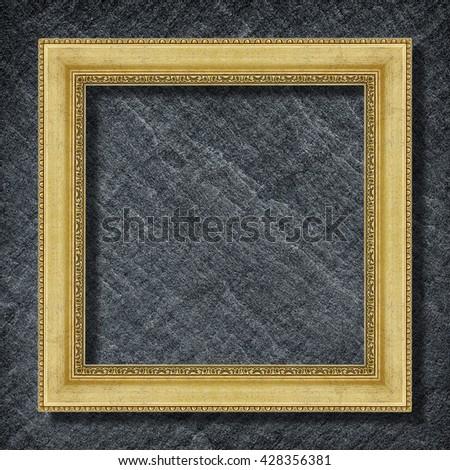 gold frame on Dark grey black slate background ,frame background - stock photo