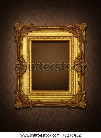 Gold frame stuck on the wall wallpaper thai the dark. - stock photo