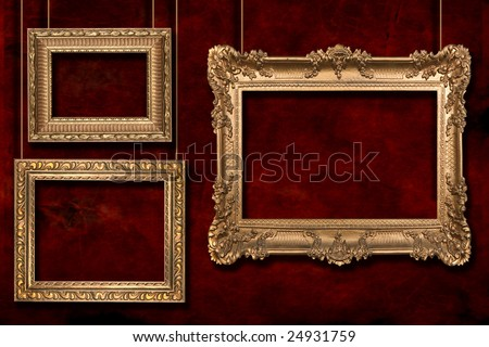 Gold Frames Hanging From Wire Poles on Grunge Background