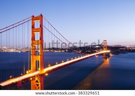 gold gate bridge in blue sky at dawn
