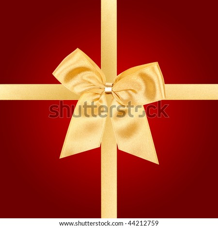 Gold gift bow on square red card