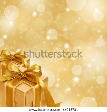 gold gift box on abstract gold Christmas background