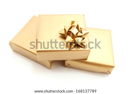 gold gift box with gold bow isolated on white