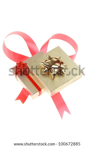 gold gift box with pink bow isolated over white background - stock photo