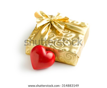 gold gift box with red heart on white background - stock photo