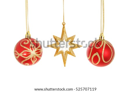 Gold glitter Christmas star with two red and gold baubles isolated against white