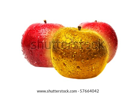 Gold glowing apple and red apples - business concept; expressing the ideas of richness, uniqueness, leader in the group. - stock photo