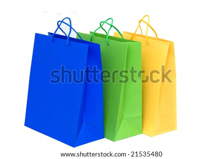 gold, green and blue holidays paper-bags for packing presents isolated on white - stock photo