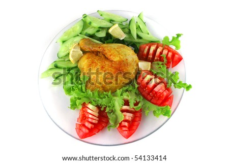 gold grilled chicken leg served with vegetables - stock photo