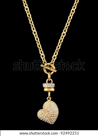 Gold heart with brilliants, pendant isolated on black background - stock photo