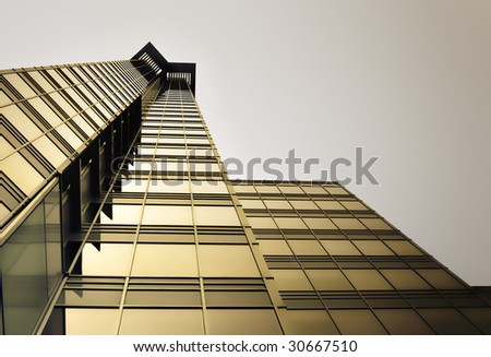 Gold Highrise against Dark Sky - stock photo