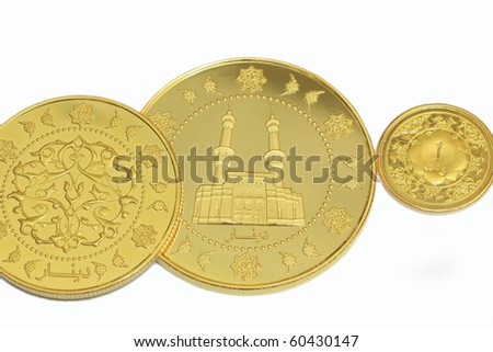 Gold in dinar with isolated white background - stock photo