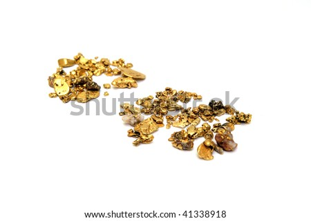 Gold in nugget form mined from the rivers and streams of California isolated on white - stock photo