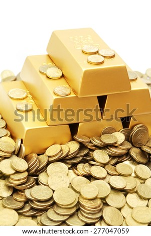 Gold ingots with gold coins - stock photo