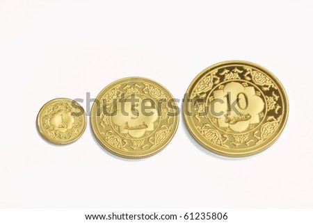 Gold islamic dinar on isolated white background