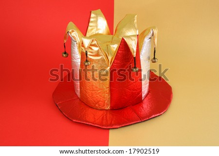 Gold Jesters Hat has the red-yellow background - stock photo