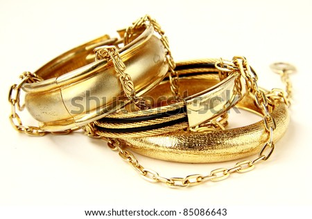 gold jewelry, bracelets and chains - stock photo