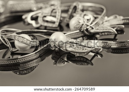 gold jewelry mixed : rings, chains and earrings . Sepia - stock photo