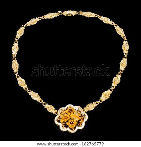 Gold jewelry necklace on a black background - stock photo