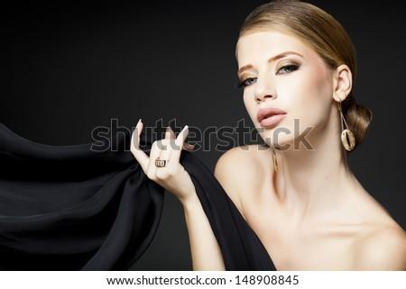 gold jewelry on beautiful woman model posing glamorous  - stock photo
