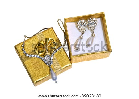 Gold jewelry sets in open boxes. Isolated white background