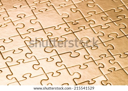 Gold jigsaw puzzle background  - stock photo