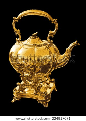 Gold kettle for tea or coffee - stock photo