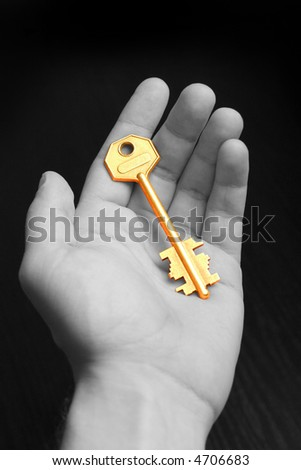 gold key on hand. B/W - stock photo