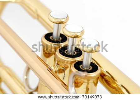 gold lacquer trumpet valves on white background - stock photo