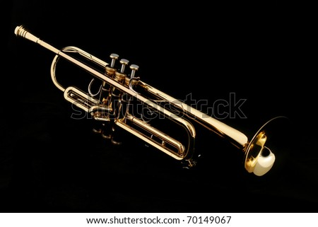 gold lacquer trumpet with mouthpiece on black - stock photo