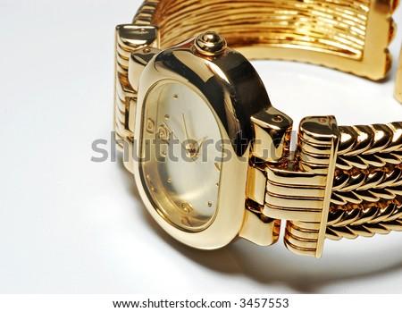 Gold ladies wristwatch - stock photo