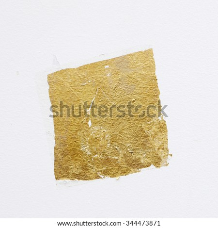 gold leaf on white wall texture background - stock photo