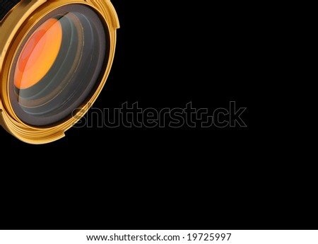 Gold lens on black background observation preview - stock photo