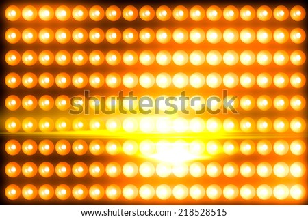 gold light panel background glowing with some flare - stock photo