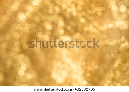 Gold Lights Festive background. Abstract bright background with bokeh defocused gold lights - stock photo