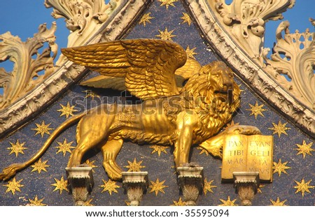 Gold lion on starred blue background of St Mark's Basilica in Venice, Italy