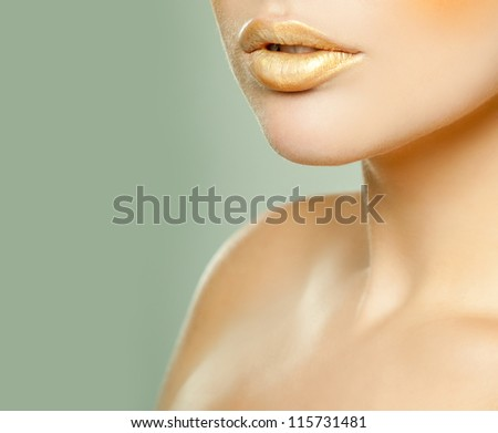 Gold Lipstick - stock photo