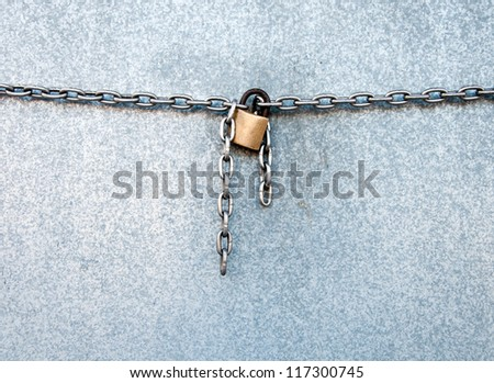 Gold lock chain fastens metal industrial box - stock photo