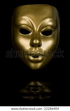 Gold mask isolated on black background - stock photo