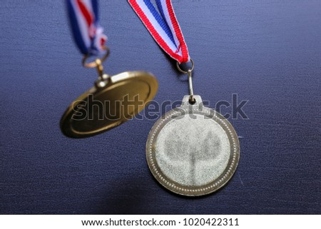 Gold medal and Tricolor ribbon