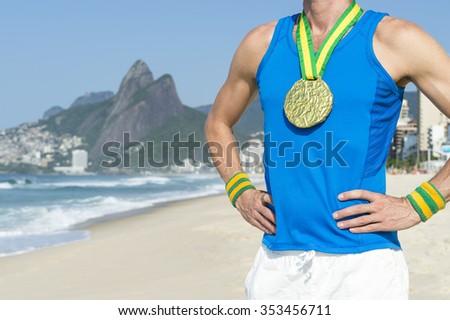 Gold medal athlete standing outdoors on Ipanema Beach in Rio de Janeiro, Brazil  - stock photo