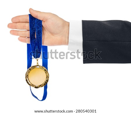Gold medal in hand isolated on white background - stock photo