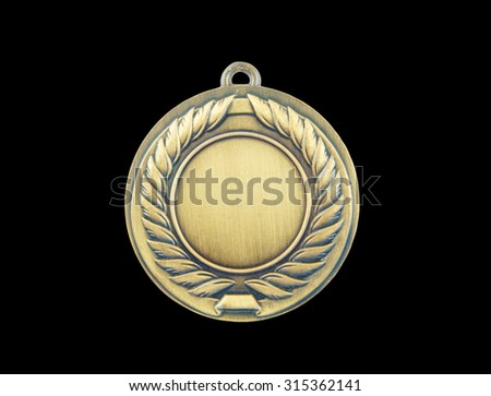 Gold medal isolated on black background - stock photo