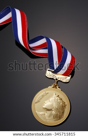 Gold medal on black background??
