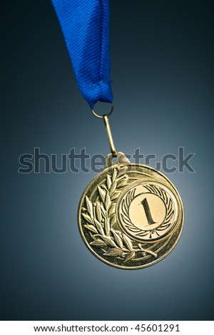 gold medal on blue - stock photo