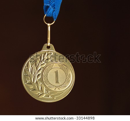 gold medal on dark background - stock photo