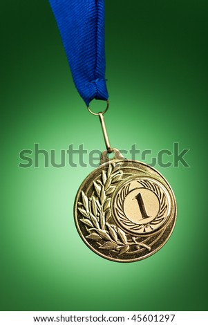 gold medal on green - stock photo